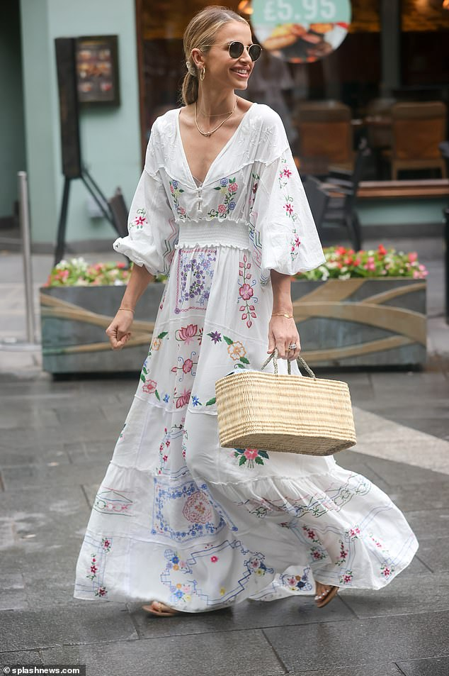 Style:The summer look featured a subtle blue note with colorful flowers, with a plunging V-neck front, billowing sleeves and a floor-length style