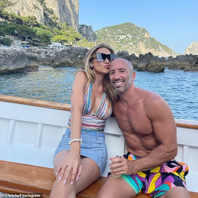 It's love! On Monday she and Oppenheim kissed and cuddled while on their romantic trip