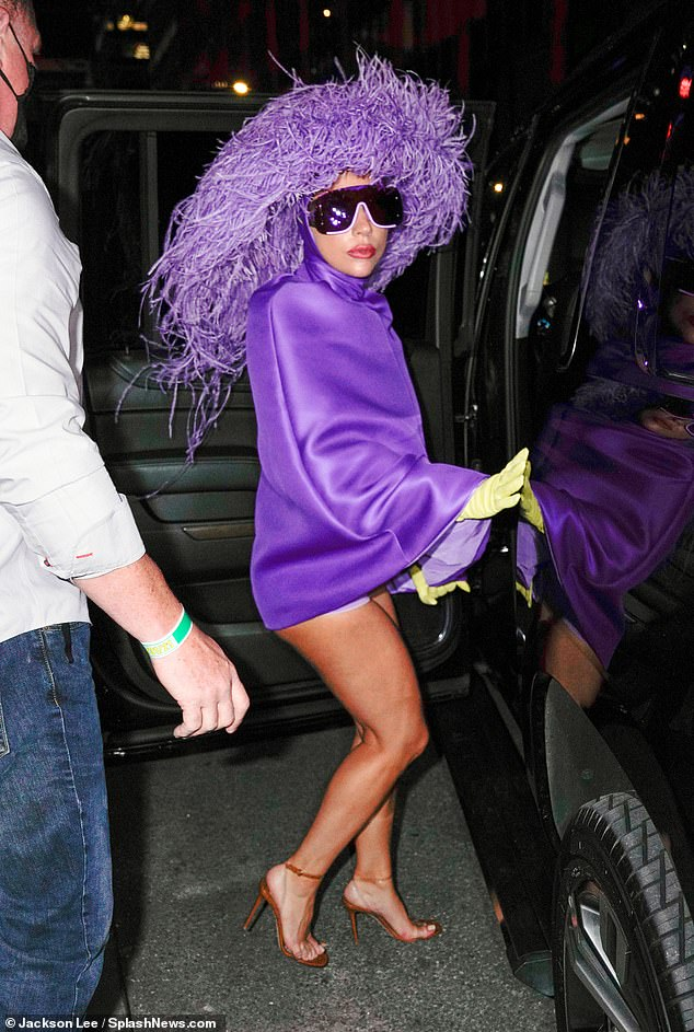 Wardrobe malfunction alert! Oscar-winning songwriter Lady Gaga got cheeky in a purple Pierpaolo Piccioli for Valentino FW/21 poncho while headed to Radio City Music Hall in Manhattan on Saturday night