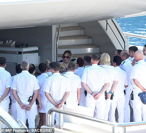 Chatting away: Clearly at ease with the yacht's staff, Jennifer chatted away to crew members before making her final descent to land