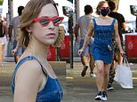 13 Reasons Why actress Tommy Dorfman dons a denim minidress as she steps out in New York City