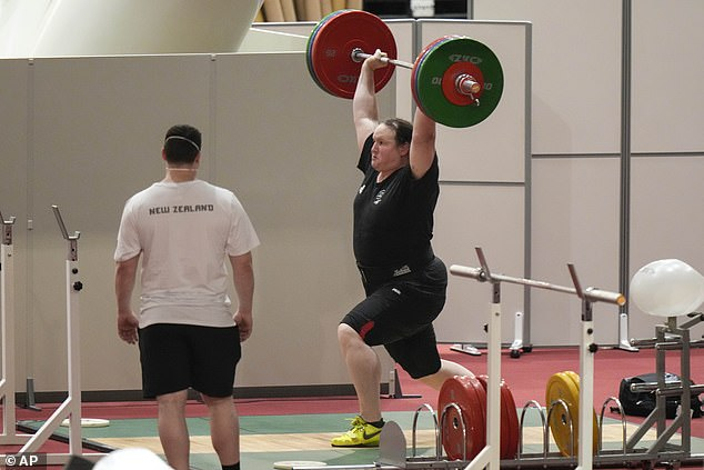 Laurel Hubbard, 43, was pictured on Saturday morning warming up and practicing her lifts under the watchful eyes of her coaches