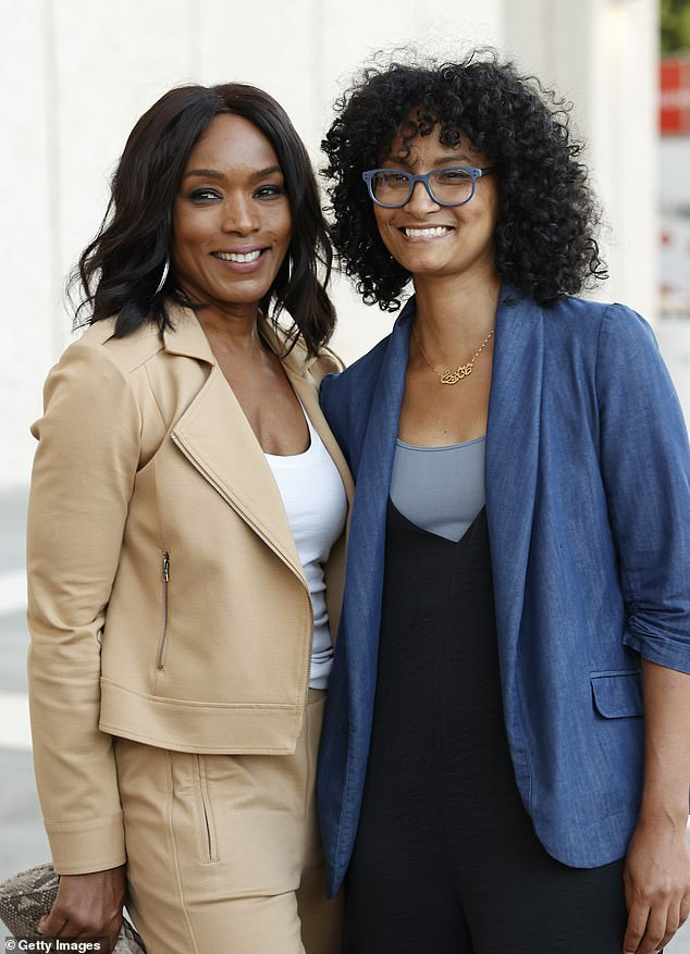 The director: Angela also showed her support by joining Jamila Wignot, who directed and produced the documentary they were about to see, on the red carpet