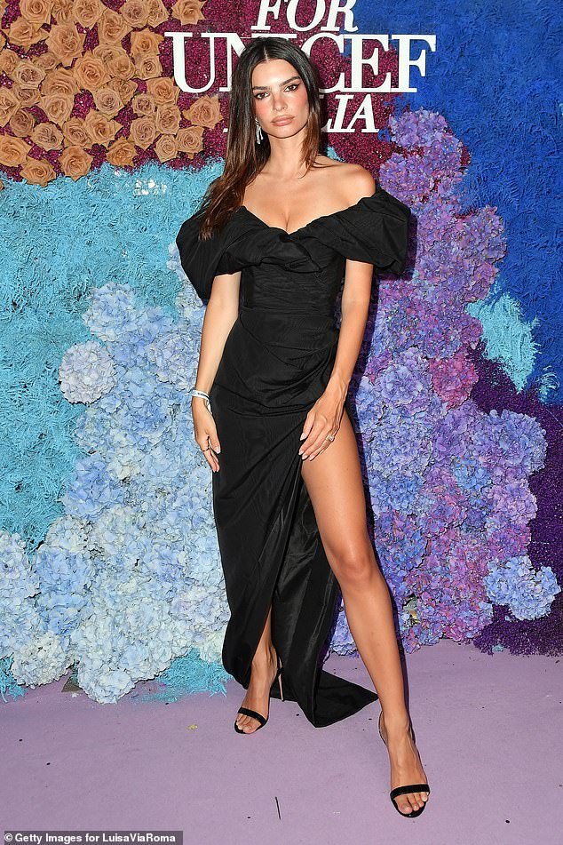 Oh my!Emily Ratajkowski oozed sexy style as she hit the red carpet in a perilously slashed dress which showed off her staggering legs at theannual UNICEF gala in Capri on Sunday