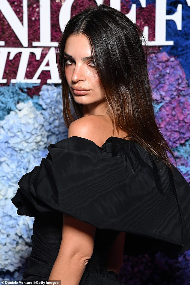 Wow:Her beauty regimen was kept simple to allow the gown to speak for itself, with her brunette locks straight and falling from a centre parting and her make-up simple