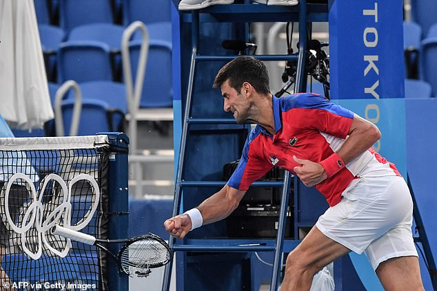 He also smashed a racket and hurled it into the net during an epic meltdown on court