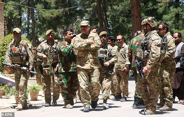 Afghan security officials arrive as part of a reinforcement to fight against Taliban militants as they push to gain access to the city in Herat