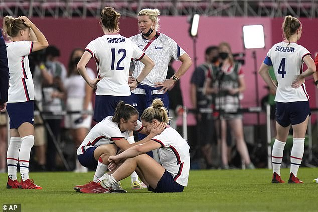 United States' Kelley O'Hara, left, talks to teammate Lindsey Horan after being defeated 1-0 by Canada during a women's semifinal soccer match at the 2020 Summer Olympics