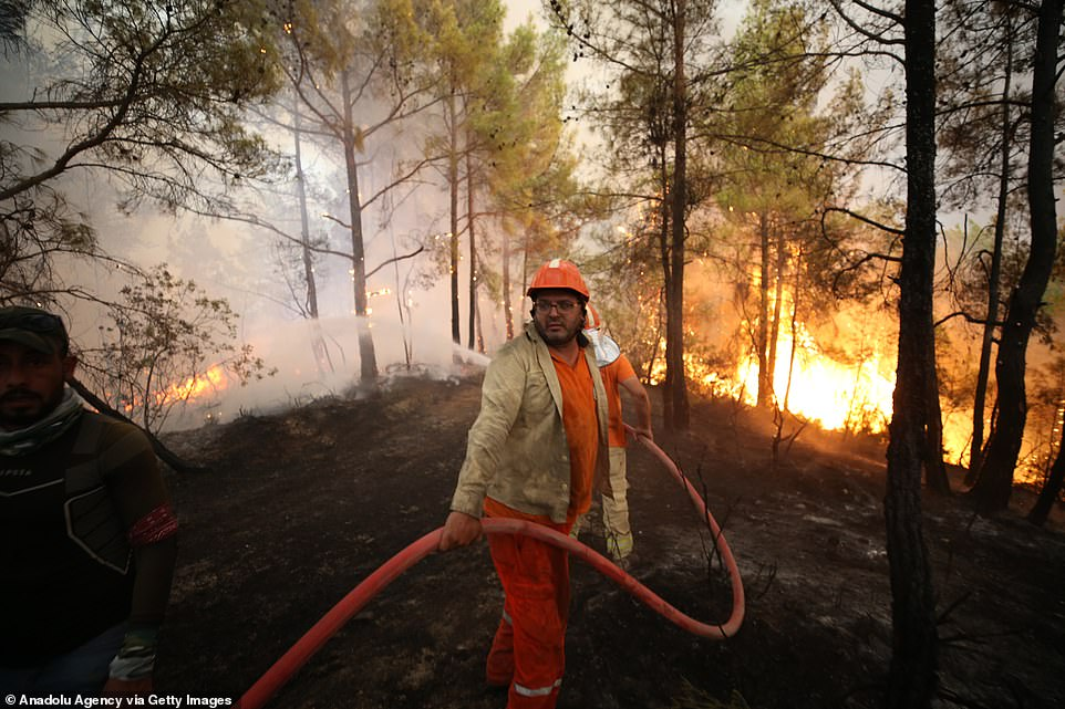 Firefighters battle against flames in Turkey'sAntalya region which have now been burning since last week