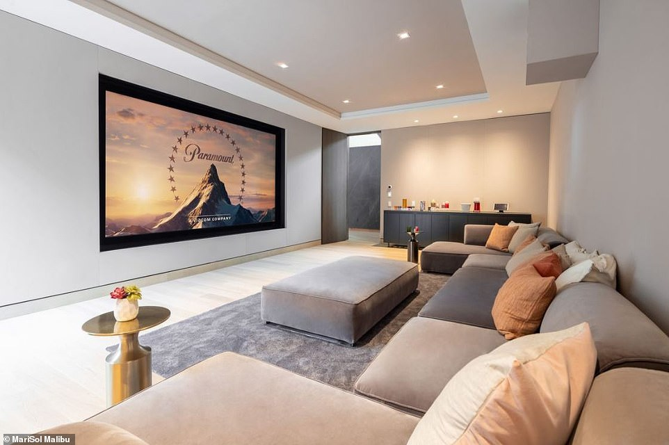 Inside the home's facilities, a theater, wine cellar and steam fireplace create a