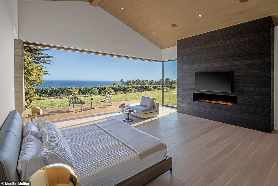 The house is located on 2.48 acres and boasts 6 bedrooms, 9 bathrooms and a seawater pool.
