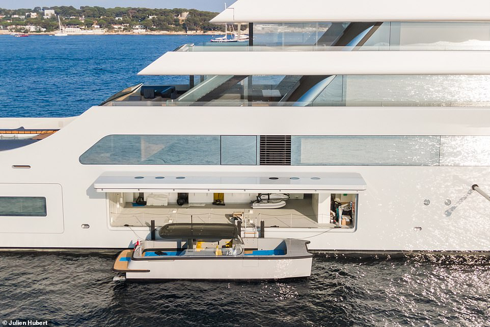 This exclusive series of photographs and videos shows for the first time the full majestic grandeur of the boat as it awaits its secretive oligarch owner and his friends