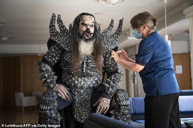 Jabbed: On Sunday, Mr. Lordi AKA Tomi Petteri Putaansuu of Finnish hard rock band Lordi received his second vaccine against Covid-19 from nurse Paula Ylitalo (R) in Rovaniemi, Finland