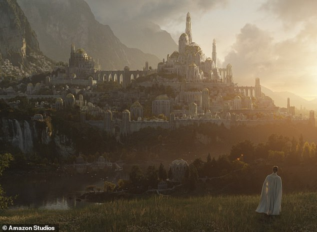 Take a closer look: The streaming giant also unveiled the show's first image set in the Second Age of Middle-earth of a mysterious caped figure looking at a castle