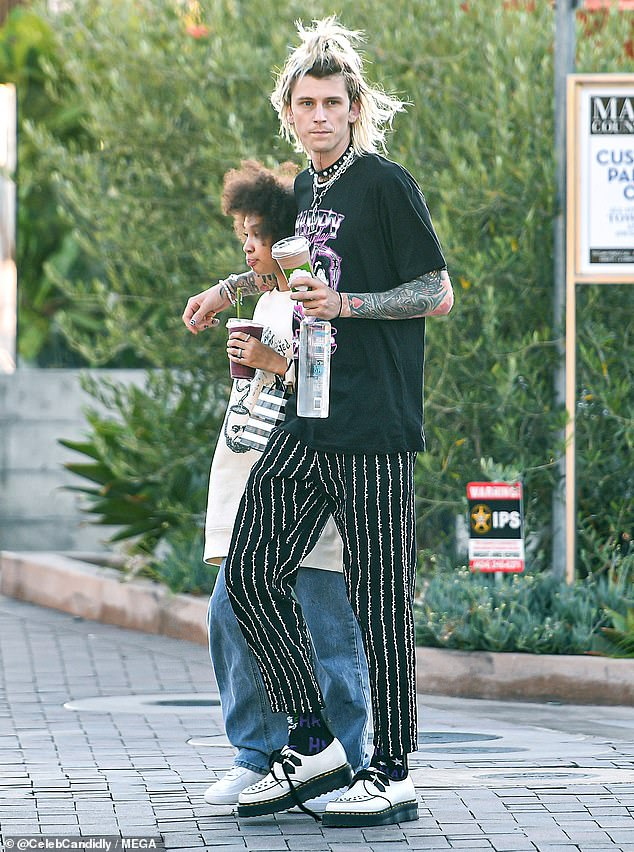 Cool Dad: Machine Gun Kelly had wild hair and an even weirder look while spending quality time with daughter Casie, 13, in Malibu on Sunday