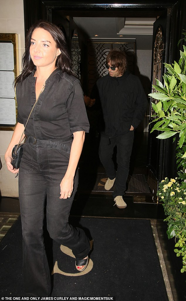 Sunglasses: Liam wore his shaggy haircut and sunglasses, pairing his black pants with a coat