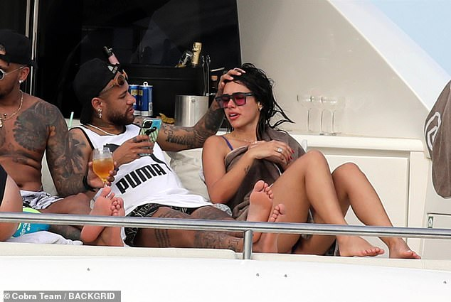 Chilled: The footballer and his friends seemed to be the epitome of relaxation on the yacht