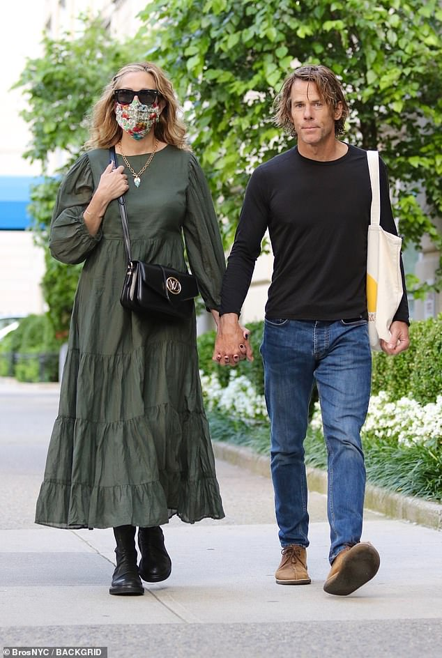 Going strong! Roberts and her husband of 19 years looked like a new couple as they sweetly interlocked hands