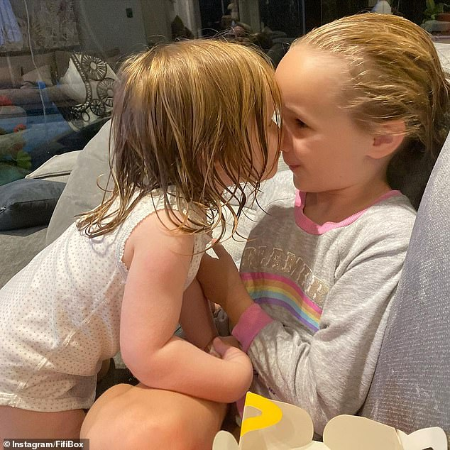 Claims: 'Fifi has got so much love to give,' an insider said. 'Any child would be so lucky to have her as their mum.' Pictured: Trixie Belle, eight, and Daisy, two