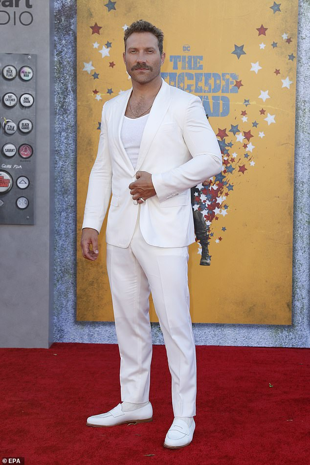 Ready for the red carpet: He wore a cotton tank top that exhibited a hint of his hairy chest under his tailored jacket to match his pants and designer dress shoes