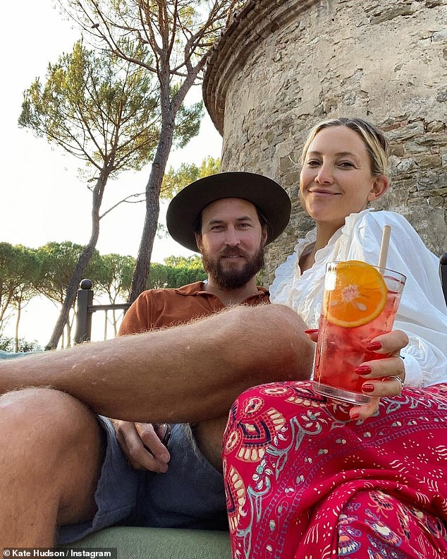 Cute: Kate Hudson and her boyfriend Danny Fujikawa looked loved-up as they posed in a sweet vacation snap in Greece together on Monday