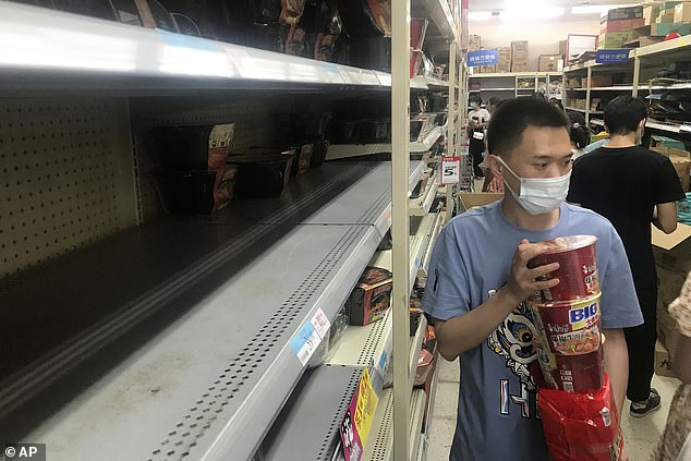 Wuhan residents were seen clearing out supermarket shelves in the city on Monday