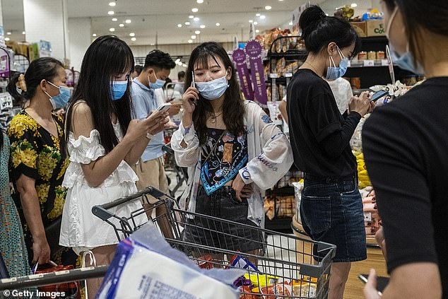 Panic buyers in Wuhan on Monday amid fears the city is about to plunged into another brutal lockdown