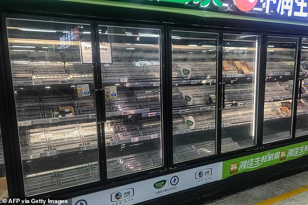 Panic-buyers emptied shelves in supermarkets across Wuhan ahead of a new lockdown after the city reported its first local cases in more than a year
