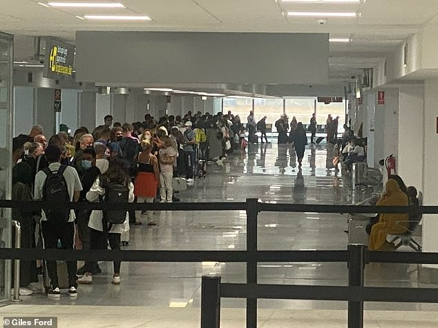 British holidaymakers faced travel chaos on Tuesday with hour long waits to clear passport control at Malaga airport