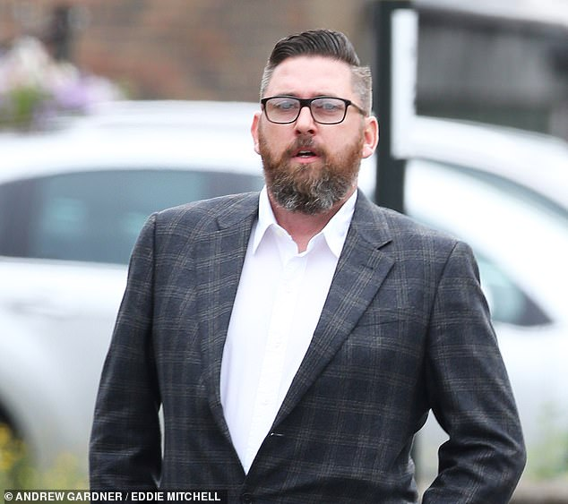 James Hollett, 40, pictured today outside Crawley Magistrates' Court, pleaded not guilty to stealing the Audi. He is accused of filming himself one handed driving on the M23 in Sussex at more than 200 miles per hour