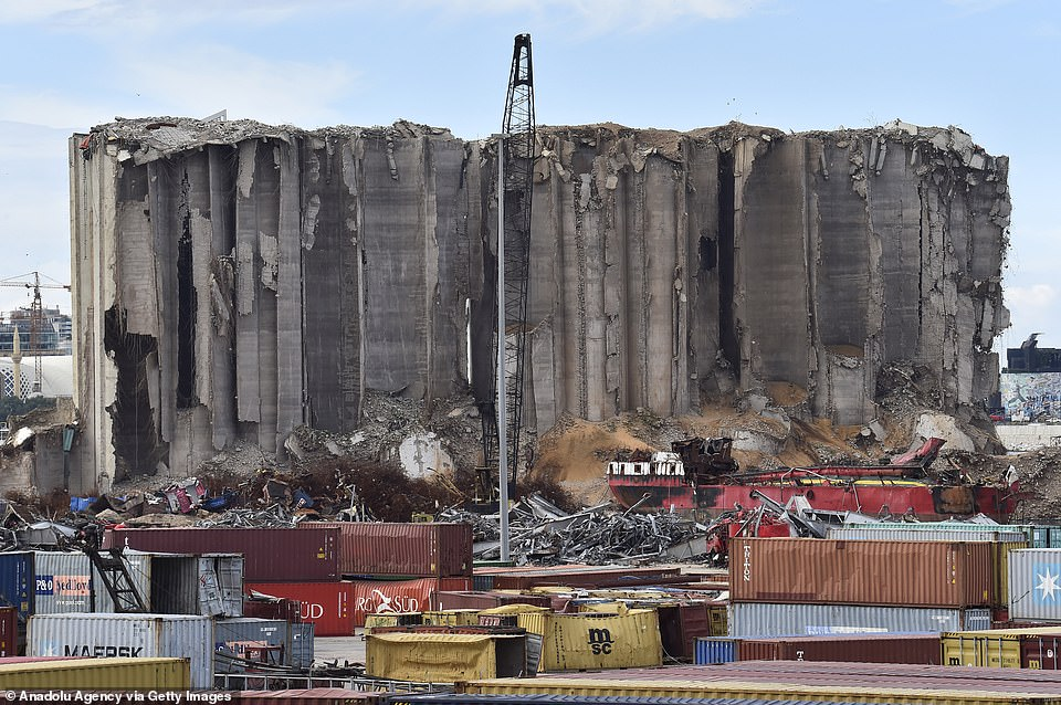 The explosion blow apart concrete grain silos at the port, which remain completely destroyed a year on from the explosion