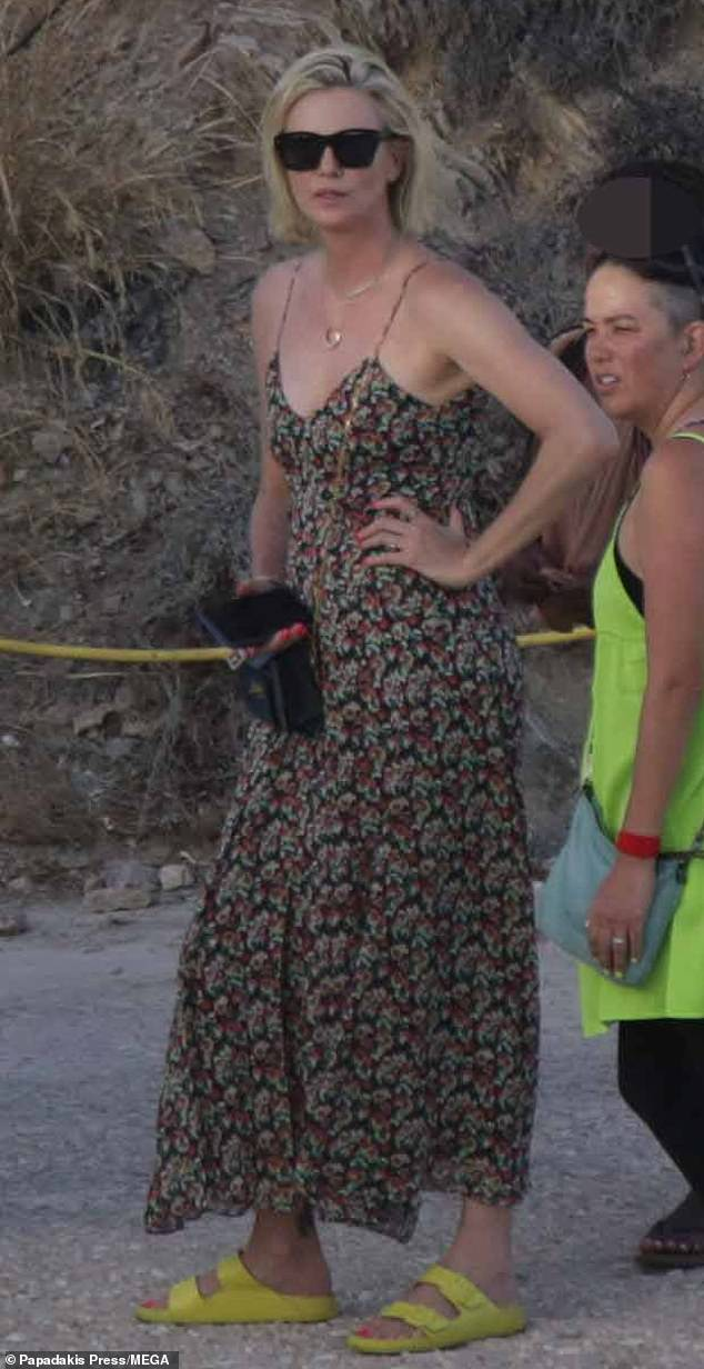 Gorgeous: Charlize Theron, 45, looked effortlessly chic in a flowing maxi dress as she enjoyed a family day out on the Greek island of Antiparos on Tuesday