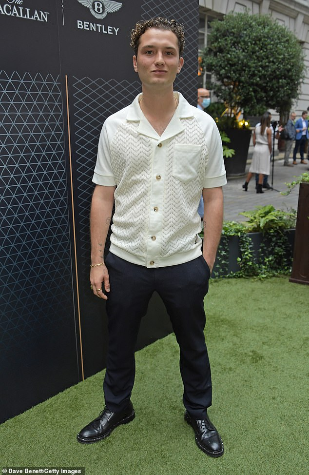 Posing up: The son of Hollywood star Jude Law and model Sadie Frost opted for a white buttoned down bowling-style shirt with a chevron-patterned fabric