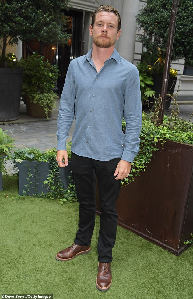 Keeping cool: Jack donned a smartly pressed blue shirt and a pair of black trousers which he teamed with brown leather shoes for the evening