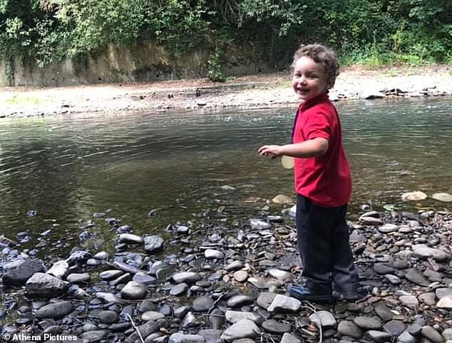 Logan, five, is pictured at the Ogmore River in Sarn near Bridgend where he was found dead on Saturday