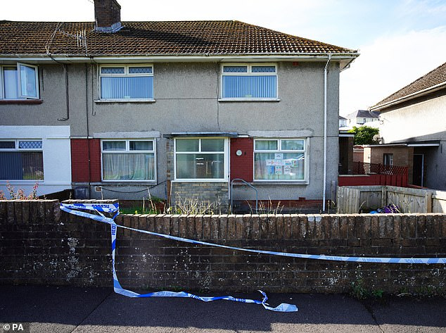 Police tape at a property in the Sarn area of Bridgend, near to where five-year-old Logan was found dead
