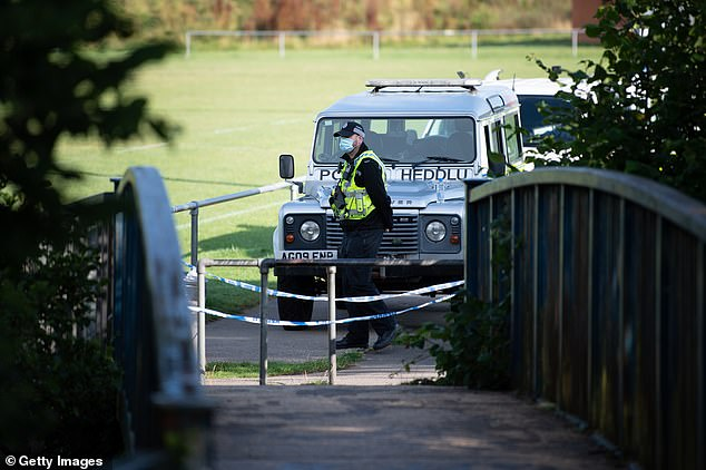 A police officer near the scene after Logan was found in the Ogmore River in the early hours of Saturday morning