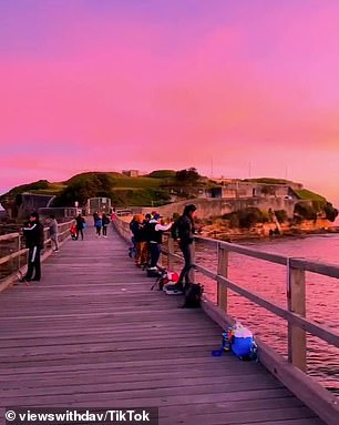 The island and surrounds are completely transformed with 'colour coming out of nowhere, as the sun goes down