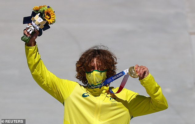 Gold Coast teenager Keegan Palmer with his gold medal after winning the final of the men's skateboard in Tokyo on Thursday