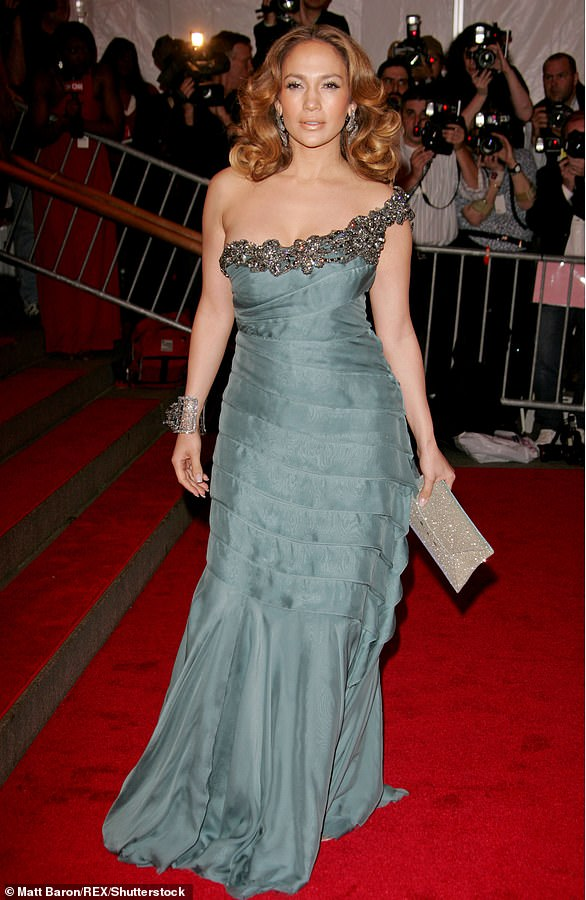 2008:In the year 2008 the Wedding Planner actress went with a more feminine look as she had on a dusty green one-strap gown with heavy embellishments on the neckline and several folds
