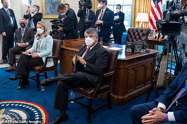 Trumka (center) was an important ally for the Biden White House in tackling the economic damage of the coronavirus pandemic. He is pictured in the Oval Office during a meeting on the administration's coronavirus response bill