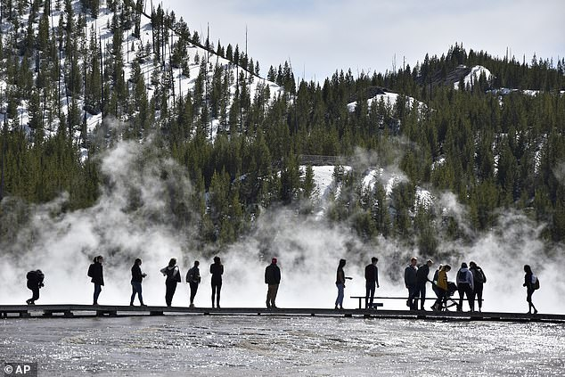 Yellowstone National Park sits in the northwest region of Wyoming and is home to bursting geysers, steam vents and bubbling pools. At 3,472 square miles, the park is larger than the states of Rhode Island and Delaware combined