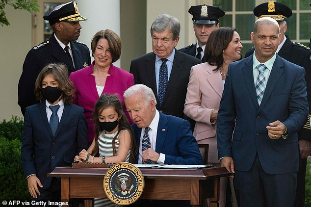 Logan and Abigail Evans got a close up view of the signing ceremony in the White House Rose Garden as Biden honored the capital's police officers