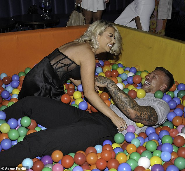 Playful mood: The couple proved their marriage is still strong as they larked about in a ball pit at the venue for Alex's belated party after he turned 30 in May