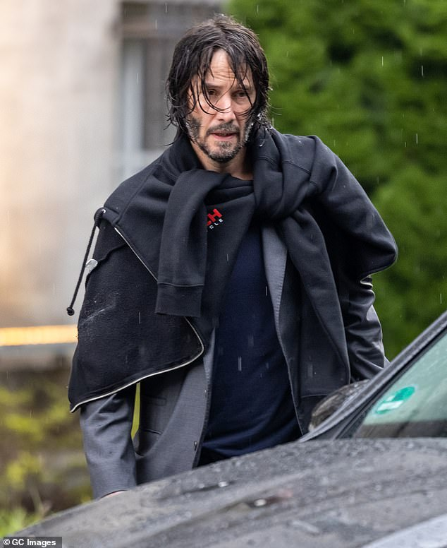Low-key:Keanu Reeves, 56, cut a laid-back figure as he exited his hotel in Berlin to resume work on the action blockbuster on Thursday