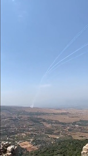 The Israeli Defence Forces posted footage of the rocket fire, tweeting: 'More than 10 rockets were fired from Lebanon into Israel, most of which were intercepted by The IDF Aerial Defense System'