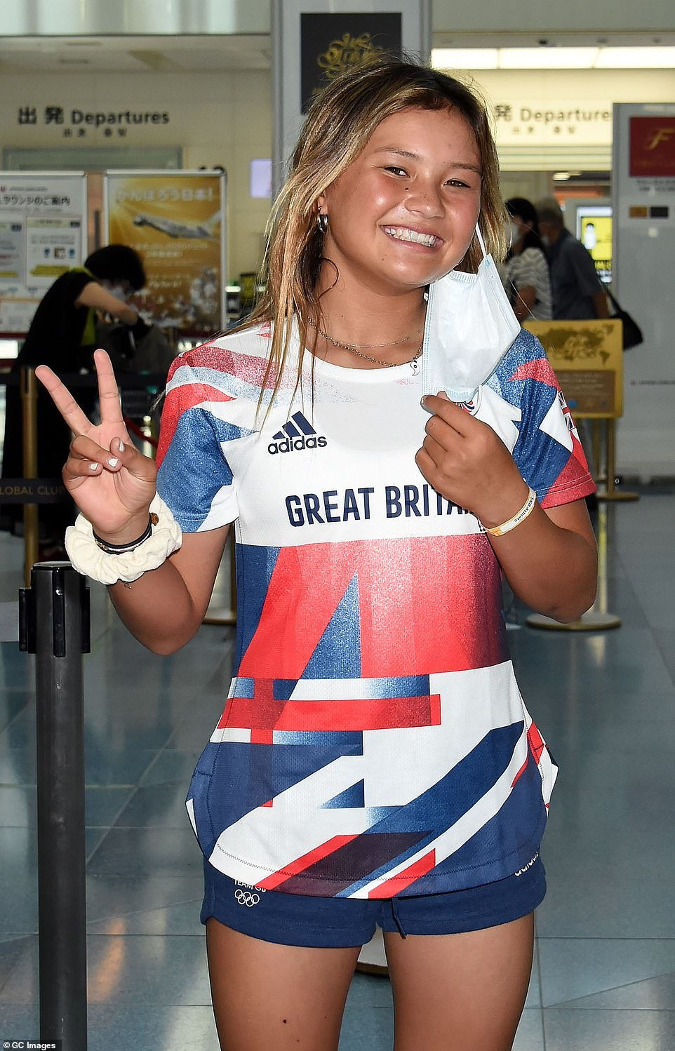 Sky Brown pictured as she returned to the UK today, having won a bronze medal in the skateboarding, despite being just 13 years old