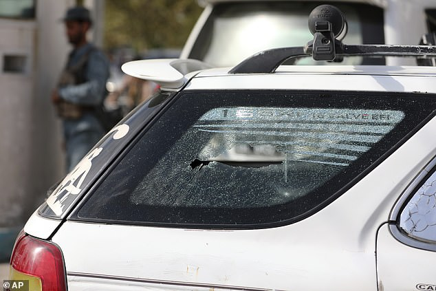 Many fighting to sustain a liberal Islamic administration have previously been assassinated by Taliban fighters. Above, a bullet hole is seen on the window of vehicle in which Khan was killed