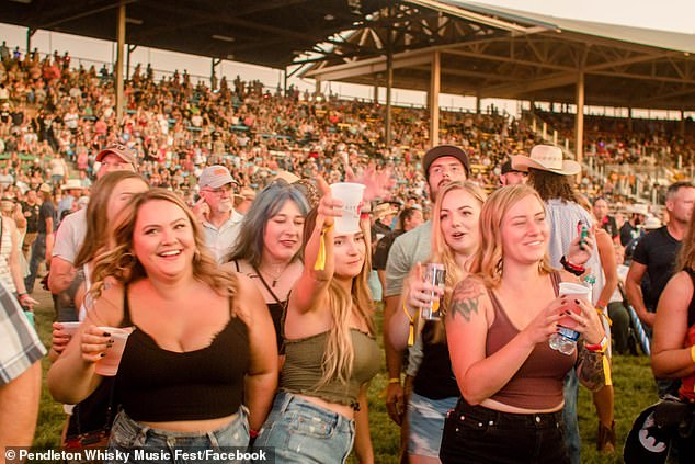 Pendleton Whisky Music Fest in Pendleton, Oregon, has been tied to 62 COVID-19 cases. Pictured: Pendleton partygoers enjoy live music on July 10