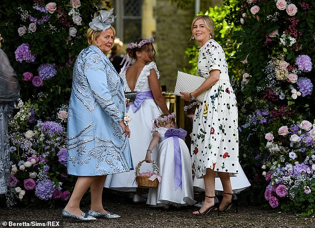 Kind: Dec's wife Ali Astall, 43, lent a helping hand to a group of young bridesmaids